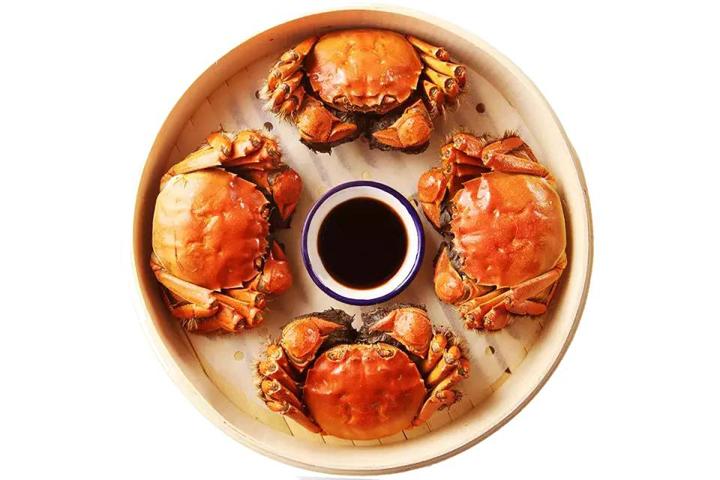 螃蟹和茶可以一起吃吗